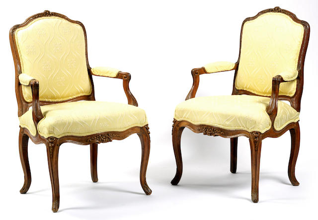 A pair of Louis XV carved beechwood fauteuils