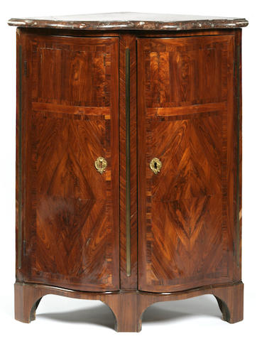 A Louis XV tulipwood serpentine-fronted encoignure