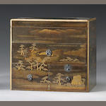 A Japanese lacquer storage box with cart and pine decoration, 19th Century