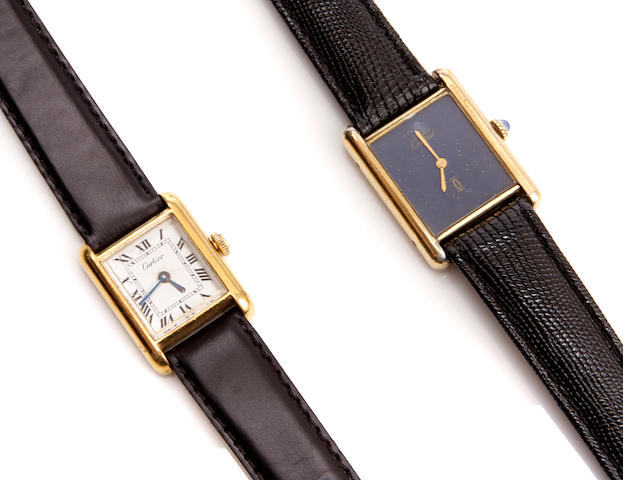 A collection of two Cartier wristwatches with a rectangular wristwatch
