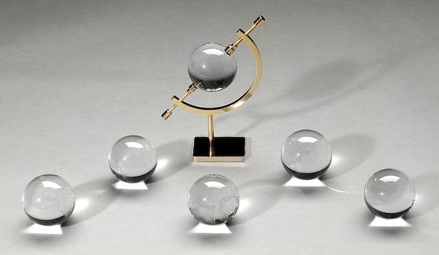 "Group of six ""optical quartz"" spheres"