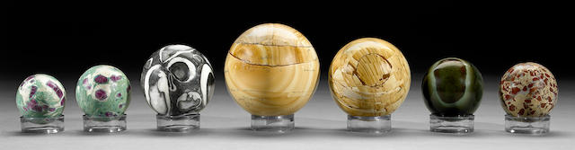 Group of seven opaque polished spheres