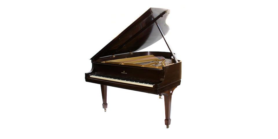 A Steinway mahogany baby grand piano and stool