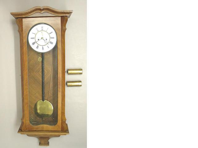A Viennese walnut regulator wall clock