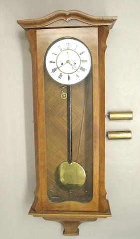 A Viennese walnut regulator wall clock
