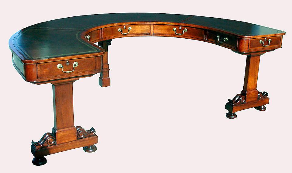 A Regency style mahogany semi-circular desk