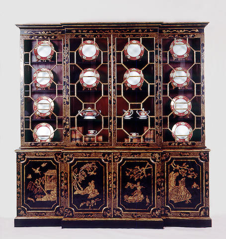 A superb George III style parcel gilt, chinoiserie decorated and ebonized breakfront bookcase cabinet