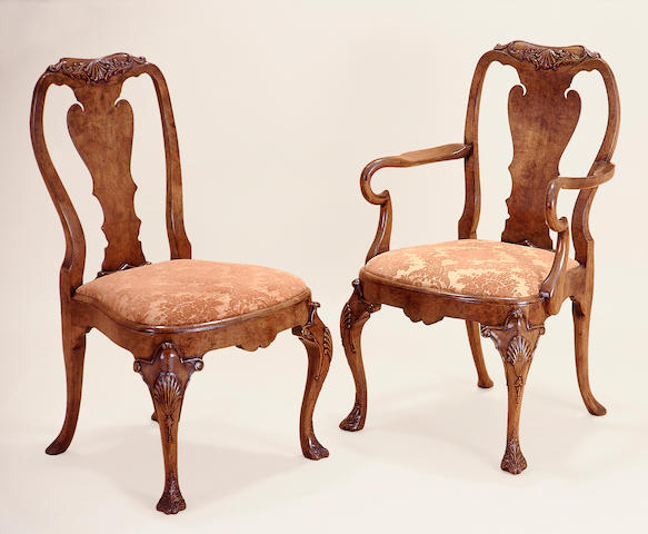 A set of twelve Queen Anne style carved walnut dining chairs