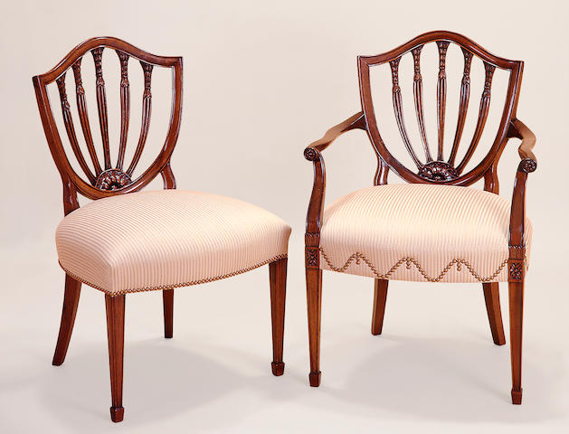 A set of twelve George III style mahogany shield back chairs