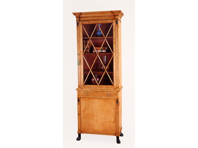 A pair of Regency style parcel ebonized maple bookcase cabinets