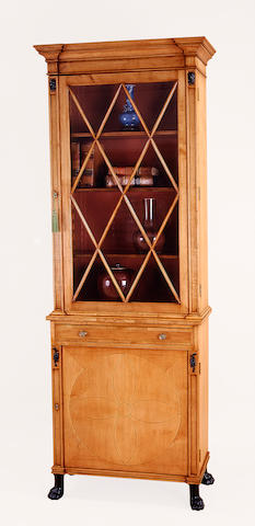 A pair of Regency style parcel ebonized maple bookcase cabinets