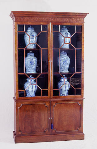 A George III style mahogany bookcase cabinet