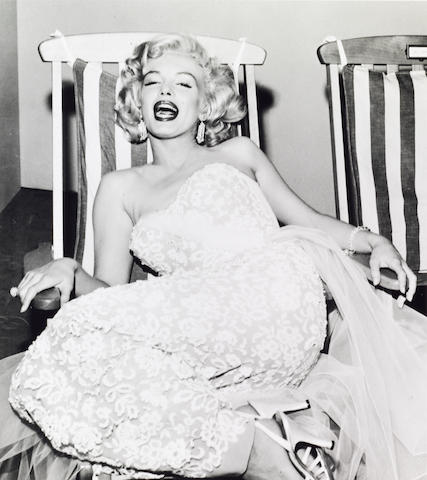 A Frank Worth photograph of Marilyn Monroe in a yachting deck chair