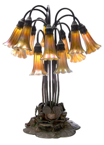 A Tiffany Studios Favrile glass and patinated-bronze twelve-light Lily table lamp