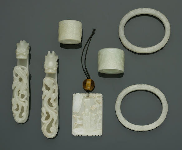 A group of seven white jade carvings  19th Century and Later