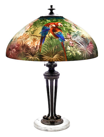 A Handel interior-painted glass and patinated metal Parrot lamp