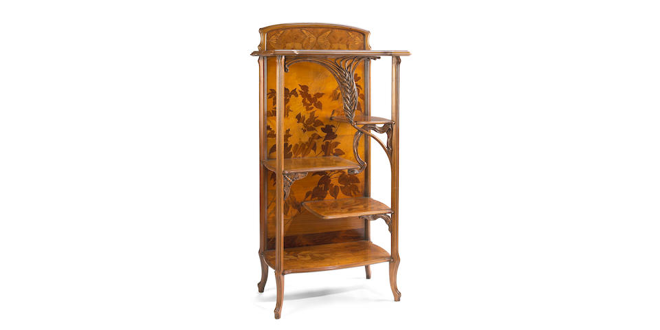 An Art Nouveau style marquetry and fruitwood étagère