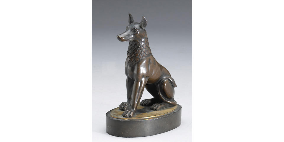 A French patinated, gilt bronze and black slate figure of a Egyptian jackal