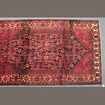 A Baluch rug size approximately 5ft. 6in x 9ft. 7in.