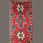 A Turkish runner size approximately 4ft. 7in. x 11ft. 1in.