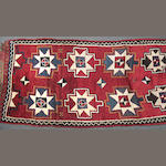 An Turkish runner size approximately 4ft. 5in. x 9ft. 7in.