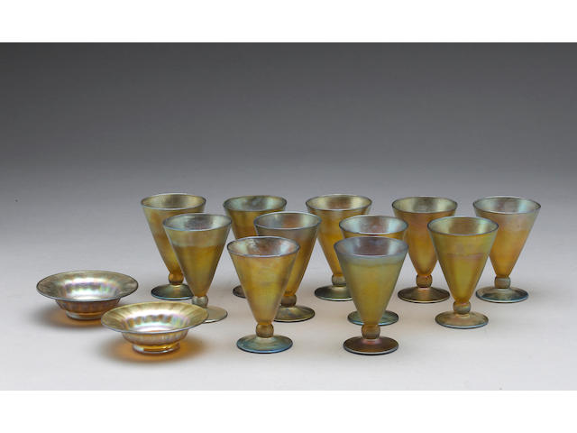 Eleven Nash iridescent glass cocktail goblets and pair small dishes