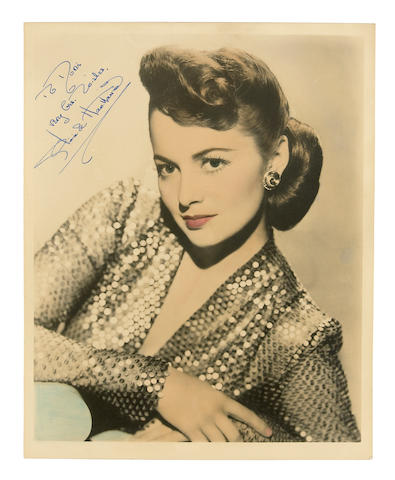 An Olivia de Havilland signed hand-tinted color photograph, circa 1940