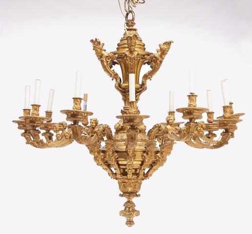 A Régence style gilt-bronze twelve-light chandelier