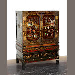 A pair of chinoiserie decorated cabinets on pedestals