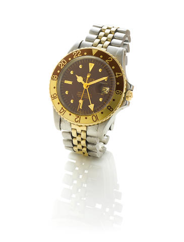 Rolex. A stainless steel and gold automatic centre seconds calendar twin time zone bracelet watch GM