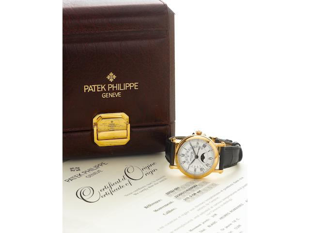 Patek Philippe. A fine 18K gold automatic center seconds watch with retrograde perpetual calendar and moon phasesRef.5059J, Case no.4259582, Movement no.3236627, Sold May 5th, 2006