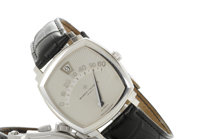 Vacheron Constantin. A very fine and rare limited edition 18k white gold jump-hour wristwatch with r