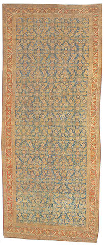 A Northwest Persian long carpet size approximately 5ft. 10in. x 14ft.