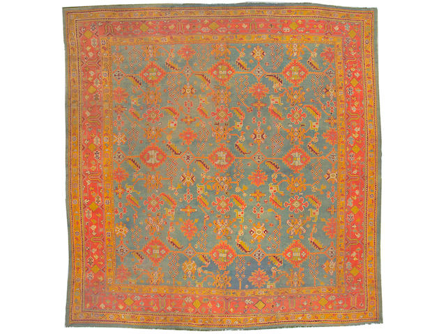 An Oushak carpet West Anatolia, size approximately 13ft. 6in. x 14ft.