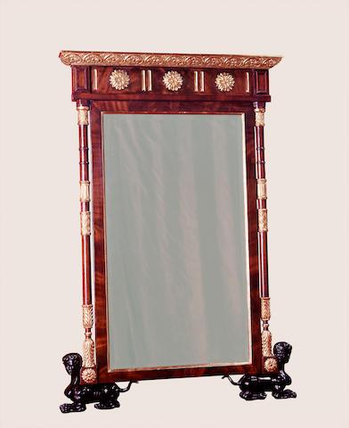 An Italian Neoclassical style walnut, parcel gilt and ebonized Piedmontese style mirror