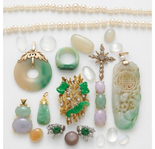A collection of jade, pearl and gold jewelry, including an 18k gold, diamond and jade brooch, a pair of jade, diamond and 18k white gold earrnigs, two lavander and green jade pendants, one carved jade pendant, a carved jade ring, two strands of pearls, one lavander jade carving, a jade bi and a collection of loose moonstones