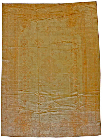 An Oushak carpet West Anatolia, size approximately 7ft. 9in. x 10ft. 11in.