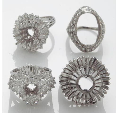 A collection of four diamond and 18k white gold mountings