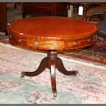 A George III style mahogany and leather drum table