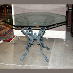A Contemporary cast iron and beveled glass table