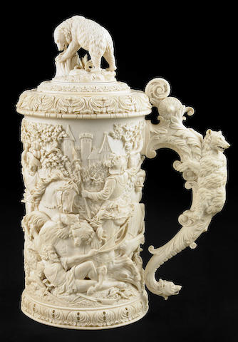 A Continental carved ivory tankard