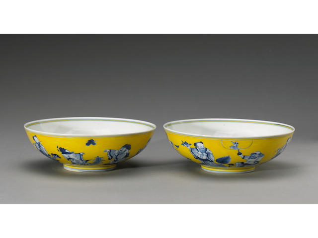 A pair of blue and white porcelain 'Eight Immortals' bowls Guangxu Marks and Period, the yellow enam