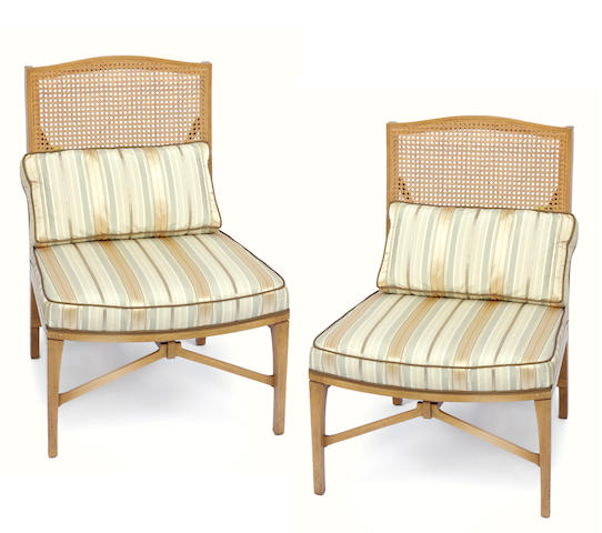 A pair of mid-century modern caned back and upholstered side chairs