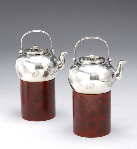 A pair of silver sake pouring vessels Taisho/Showa Period