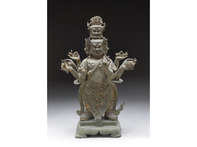 A  cast bronze standing figure of a guardian deity 18th Century