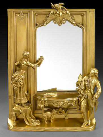 A French gilt bronze figural mirror