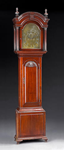 A Chippendale carved cherrywood tall case clock