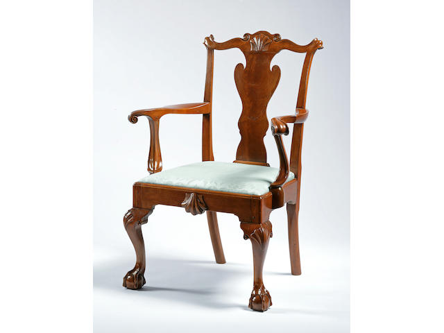 A Queen Anne carved walnut armchair