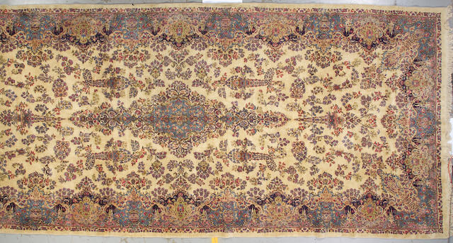 A Kerman carpet South Central Persia, size approximately 8ft. 7in. x 20ft. 1in.