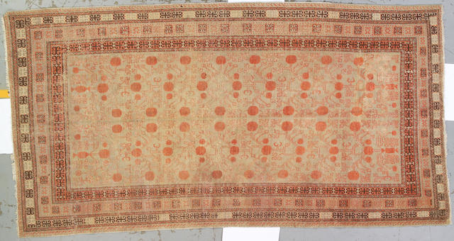 A Khotan long carpet East Turkestan, size approximately 6ft. x 11ft. 6in.